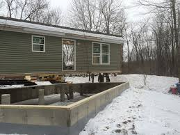 Modular home being set on customers foundation .