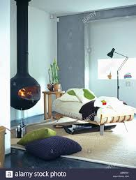 Circular Bed Suspended Circular Black Stove And Beige Carpet In Modern Gray