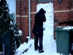 wall of snow front door of snow