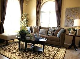 area rug with brown couch red