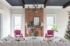 vintage living room black ceiling brick fireplace dark wood beams anthropologie home tufted sofa 5 of 23