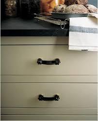 black glass cabinet pulls. Above: A Kitchen Cabinet Detail Via Martha Stewart. Black Glass Pulls