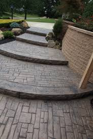 Stamped concrete patio with stairs Basic Stamped Cascading Stamped Concrete Steps Unique Concrete Design Llp Bt Kleins Landscaping Hardscapes Steps