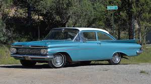 In 1960 I bought a 1959 Chevy Biscayne. The tall tail fins had now ...