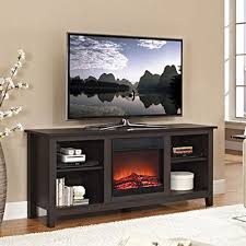with adjule shelving to hold all of your television accessories this tv stand with an electric fireplace insert is great for any home