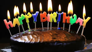 lighted candles on a happy birthday cake candles with the words happy birthday on a chocolate cake hand lights a candle happy birthday stock footage