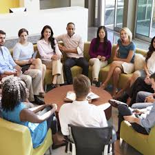 diversity inclusion talent management people at a workshop sitting in a circle