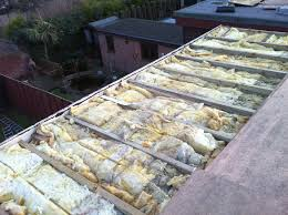 Rockwell insulation and structural plywood are added to bring the roof to  new building standards