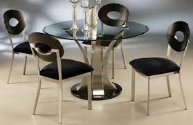 modern black round dining table. Furniture. Round Black Glass Top Dining Table With Silver Steel Vase Plus Chairs Modern S