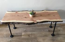 custom made live edge coffee table with pipe legs