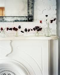 beautiful painted brick and old stone fireplace mantel designed by michelle willis adams