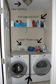 after makeover small laundry room design with new lighting wood wall mounted storage solutions and front loading washer and dryer storage for very small