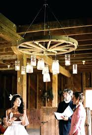 wagon wheel chandelier beautiful wedding photos under rustic mason jar with jars wagon wheel chandelier