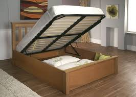 Beige Wooden DIY Bed Frame With Storage Under Black Lift Up Bed Support  Plus Cutout Headboard