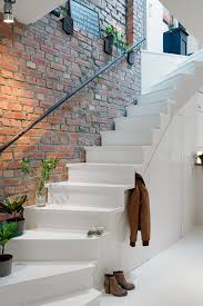 G Urban Apartment With Terrrace White Stairwell Against Exposed Brick Wall  And Natural Styling