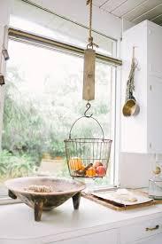 our new obsession hanging fruit baskets rh homedit com wire fruit basket for kitchen fruit basket