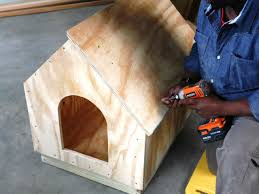 align roof panel man constructs a doghouse