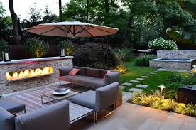 furniture patio outdoor gas fireplace in granite stone wall front brown furniture chairs set beside