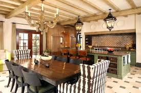 italian style kitchen antique ceiling lamps wooden table and wicker chairs in the kitchen of an italian style kitchen