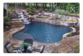 Backyard Pool With Waterfall,Gorgeous Stonework & Natural Landscaping (l  shaped deck step)