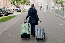 Image result for people carrying suitcases on the streets