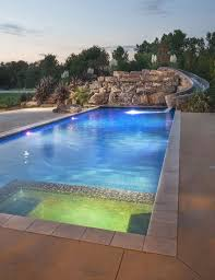 Fine Modern Pool Designs With Slide Beautiful Led Features Spillover Spa In Models Design