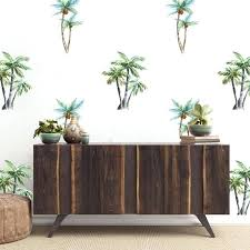 large palm tree wall decor as a pattern on white behind dark wooden urban oslo