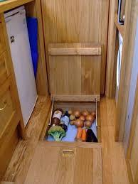 cool underfloor storage for veggies etc similar idea to the underfloor fridge idea to
