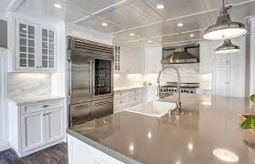 white cabinet kitchen with quartz island and marble