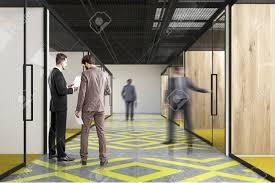 office corridor door glass. People In An Office Corridor With A Yellow And Gray Floor Pattern, Wooden Walls Door Glass