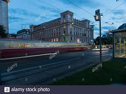 Moving tram in the evening in Vienna,Austria at a square with blue sky and  yellow lights Stock Photo - Alamy