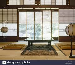japanese style lighting. Japanese Style Dining Table With Cushion In Room Oriental Lamps And Paper Blinds - Lighting I