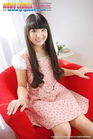 Pretty Japanese school girl posing on red armchair with her pussy.