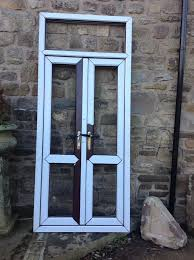 new upvc french doors with one top frame brown