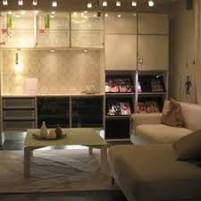 Wonderful White Open Plan Ikea Living Room With Black Couch As Ikea Showroom Living Room