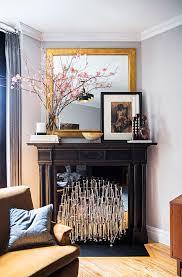 asymmetrical mantel decor