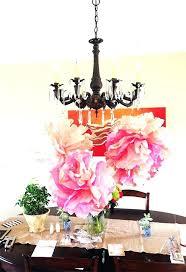 tissue paper chandelier pom pom chandelier to make the bigger tissue flowers i just folded pom