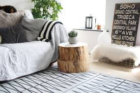tree stump furniture. Two Piles Of Wood Stump Side Table In Natural Tone Color A Small White Porcelain Pot Tree Furniture