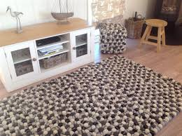 gorgeous thick black grey cream wool felt balls rug