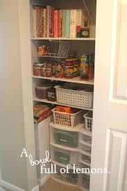 a coat closet turned pantry bowl full of lemons