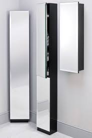 wood wall muonted tall modern bathroom storage cabinet with glass door in the corrner bathroom with small spaces ideas