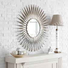 exciting family room design with sunburst mirror and table lamp plus brick wall