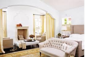 sofa for bedroom. herringbone firebox sunny yellow and beige bedroom design with cream tufted sofa gray wingback headboard oriental rug silk drapes for