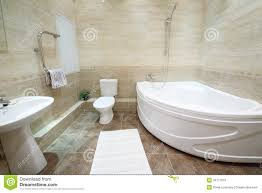 cleaning bathroom tile. Light And Clean Bathroom With Toilet Tiles On Floor Cleaning Tile C
