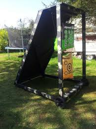 archery target stand add horse stall mats from tractor supply behind targets and wooden backstop