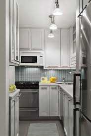 white kitchen lighting. Awesome White Kitchen With Backsplash Tile And Track Lighting Design