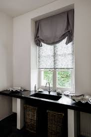 Try Tulip Roman Shades for a decorative touch in the powder room. Shown in  material