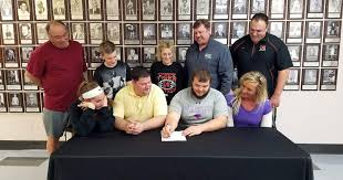 Herrin's Wells signs to play football at McKendree