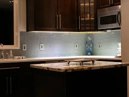 glass kitchen tiles. Kitchen Colored Glass Subway Tiles, White Counters, Natural Stone Island Tiles