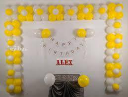 yellow white balloon decoration for